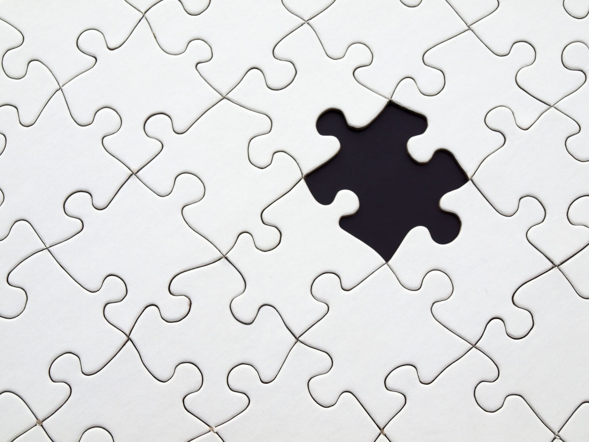 White puzzle black background missing piece